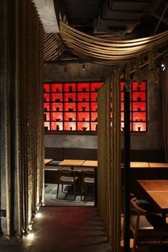Love the back lit shelves and the ropes used as room dividers. Kemuri restaurant by Prism Design, Shanghai