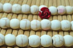 62 pcs of WhiteTurquoise synthesis matte round beads in 6mm
