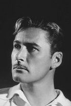 Errol Flynn    Errol Flynn was born to parents Theodore Flynn, a respected biologist, and Marrelle Young, an adventurous young woman and descendant of a midshipman of HMS Bounty fame. Young Flynn was a rambunctious child who could be counted on to find trouble. Errol managed to have himself thrown out of every school he was enrolled in...
