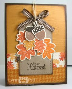 handmade card from The Queen's Scene: Happy Harvest ... Autumn card in warm Fall colors ... acorns and oak leaves stamped, die cut and placed in a groupin on a tag ... awesome card!