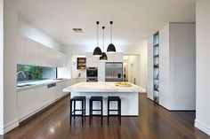 Dark pendant lights offer wonderful visual contrast in the kitchen Stools For Kitchen Island, White Kitchen Island, Rustic Kitchen, Kitchen Ideas, Classic House, Glass Panels, Kitchen Lighting, Modern Rustic, Home Renovation