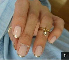 Nude mani with thin gold french tips