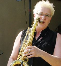 Female saxophonist cocktail party