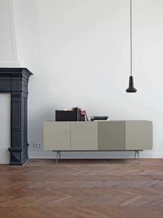 Cute Ligne Roset Book and Look Rotating Tower Structure resting on a rotating ball bearing mechanism The MDF supportbase is weighted with a steel dis u