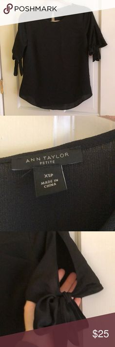ANN TAYLOR Short Sleeve Blouse Black short sleeve blouse from Ann Taylor. The sleeves tie and do have somewhat of an opening as shown in the picture. Never worn but did take the tags off. Ann Taylor Tops Blouses