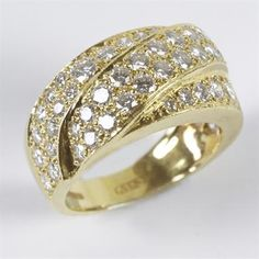 Lot 43: Ladies diamond set ring, comprising wide crossover tapered style band set with fifty six brilliant cut stones (total weight approx. 1.50 carats) all set in 18ct yellow gold. Estimate £600 - £700. Sale date 17th June 2014 www.afbrock.co.uk