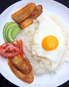 """""""Love in the Time of Cholera"""" Arroz con huevo, or rice with a fried egg, is the ultimate Latin lazy lunch. Can also add fried plantains, avocado, and tomato onion curtido salsa. Colombian Cuisine, Colombian Recipes, Boricua Recipes, Puerto Rico Food, Dominican Food, Dominican Recipes, Spanish Dishes, Spanish Food, Comida Latina"""