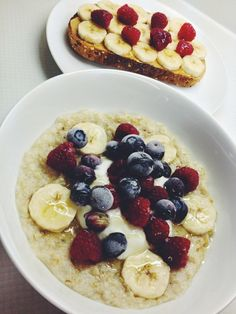 Oatmeal with banana, blueberries and raspberries.