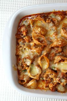Baked Cheesy Pasta - cheesy, delicious, and healthy -- triple win! Whole-wheat pasta and lean ground turkey breast plus a handful of simple add-ins and voila! - dinner is in the oven, and your home smells great! This is a week-night winner here, and you'll enjoy it too.