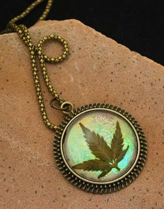 Real Marijuana Leaf Medallion Pendant by SublimeImpressions, $15.00