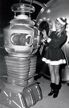 The B9 ROBOT, in a publicity photo with Marta Kristen, as it appeared in the first season of the 1960's TV series, LOST IN SPACE (original image cropped, density/exposure adjusted).