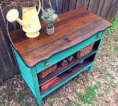 Love the dark wood color with the teal color! Would look great in my kitchen! Recycled dresser into a fun piece, painted furniture, repurposing upcycling
