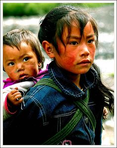 Farm Children in Sichuan, China. Look closely and one can see a distinct red on their faces, which is called 'Highland Red' (translated directly from chinese). This is due to the fact that these farm children live high up in the mountains, 3500m above sea level, and long exposure under the unforgiving sun left them with the brutal burnt skin on their faces.  I really felt sorry for these children because most of them never get a chance to study and all their life, they will be helping out in…