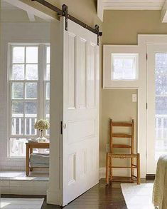 Sliding Barn Door This door isn't just a door--it also functions as a wall. The white doors are hung on barn door rollers and are easy to slide open and closed. Could be used between the living room and kitchen diner. Interior Sliding Barn Doors, Sliding Doors, Entry Doors, Patio Doors, Entryway, Wood Doors, Foyer, Barn Door Rollers, Barn Door Designs
