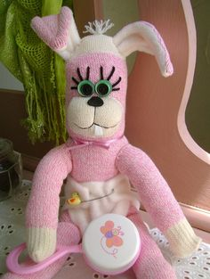 Baby Sock Bunny made from pink sock monkey socks!  :)  http://www.etsy.com/listing/77129898/bindy-the-baby-sock-bunny