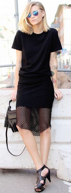 Tine Andrea of The Fashion Eaters wearing a black t-shirt with a black skirt with mesh detail