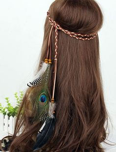 Long haired manequin in hippied peacock feather headpiece