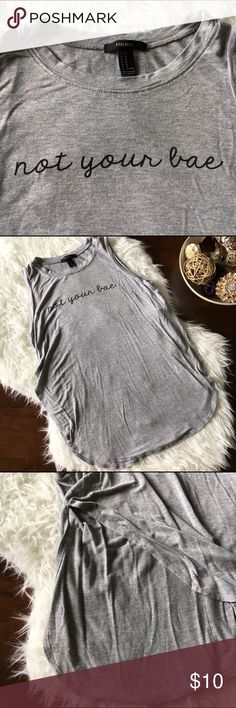 """B2G1✨ Super Soft F21 """"Not Your Bae"""" Graphic Tank Excellent used condition. Oh so soft gray high round hem tank that reads Not Your Bae. So cute! Great for workouts or lounging. Size medium. Approx measurements- armpit to armpit: 18"""", shoulder to hem: 26"""". No tears, holes, or stains. Smoke free home. No trades please. Forever 21 Tops Tank Tops"""