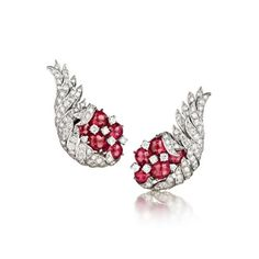"VerduraVINTAGE ""WING"" EARCLIPS - Vintage ruby and diamond ""wing"" earclips.  Platinum mountings set with 10 Burmese cabochon rubies weighing 9.83 carats and 134 brilliant-cut diamonds weighing 2.59 carats, 1964"