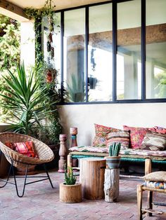 Rattan, wood, plants and kilim textiles on the terrace of a beautiful bohemian retreat in Marseillebelonging to Emma Francis (Sessun). Photography - Herve Goluza for Glamour France.