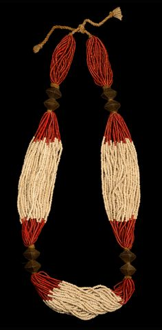 India | Necklace worn by Naga women; red and white miniature glass beads alternately, in 33 strings thread on cord material, brass chain links in form of a double cone in pairs in two places in between | Est.  500 - 1000€ ~ (Mar '14)
