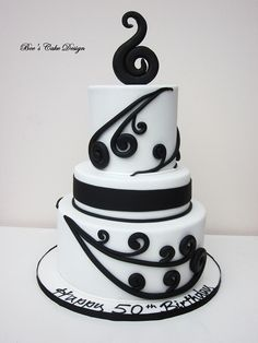 Koru Maori Cake by Bee's Cake Design    if it was in a brighter color in substitution of black, i'd love it!
