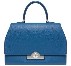 French trunk maker Moynat have created the Rejane Bag. This elegant bag is named after the famous Belle Epoque actress Gabrielle-Charlotte Reju who was a loyal client of the first Moynat store, which was near the Theatre Francais. Reju commissioned a crocodile leather trunk with a padded blue and mauve lining. This structured bag, which has a patented locking system, is made from Taurillon Gex leather with a perle calfskin lining and a detachable shoulder strap.