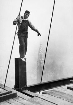 steelworker touching the tip of the chrysler building, c. 1931