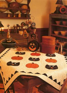 Cute Halloween quilt with blanket-stitch applique--by Barbara Brandeburg and Teri Christopherson