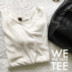 We the Free T-Shirt Adorable free people top in cream. Never worn before, it's meant to be an oversize top where you tie the side up! Extremely flattering & makes everyone feel good! Almost a canvas material  Free People Tops Tees - Short Sleeve