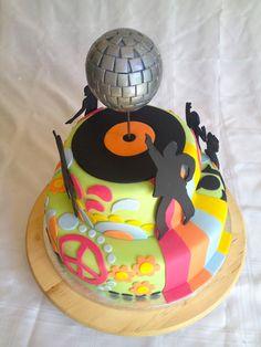 Elaine's Sweet Life: 70's Party Cake with John Travolta silhouette, disco ball, paislys, peace signs, etc.
