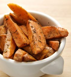 Slice and roast sweet potatoes with a drizzle of olive oil and season with salt for a sweet and satisfying snack.