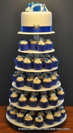 Royal Blue cupcake wrappers! Stunning.... Or something like that at the top, except instead of flowers put a baby carriage and if its a girl do purple