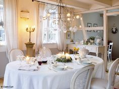 all white French maison dining room for the holidays from Campagne Decoration