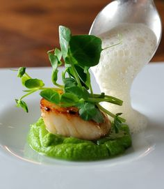 This amazing scallop recipe from Chris Horridge elevates a simple dish into something truly memorable. The combination of sweet scallops, peas, crunchy pea shoots and piquant cumin foam is sure to wow at any dinner party Fish Recipes, Seafood Recipes, Gourmet Recipes, Cooking Recipes, Seafood Appetizers, Fancy Recipes, Clam Recipes, Dinner Party Recipes, Gourmet Foods
