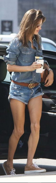 Who made Alessandra Ambrosio's brown belt, sneakers, and denim cut off shorts?