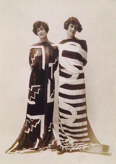Sonia Delaunay – Miss Molitor and Mrs Monnier wearing scarves of Simultane fabric nos. 22 and 15 at the Bal des Pages at Hotel Claridge, Paris. Gilbert Rene