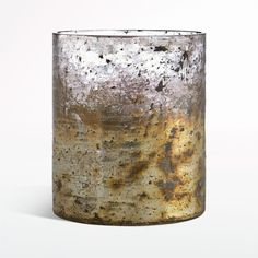 "Gorgeous with the look of burnished metal, these striking textured glass candle holders are hand sprayed with silver and gold paint. Each one is uniquely textured and colored.     Handcrafted  Textured glass with hand-sprayed paint  Accommodates up to a 2""-diameter votive or tealight candle, sold separately  Wipe with damp cloth  Made in India"