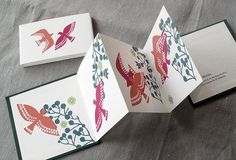 IONA BINDING - Small handmade album that measures 11.5 x 11.5 cm. Symbolic illustration of lonely and free birds meeting.