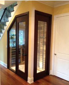 Gorgeous Wine Closet and Showcase under the stairs! Closet conversions are both attractive and functional. Showcase your wine storage with glass doors and sidelights. Follow rickysturn/diy-home-decor