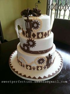 3 tier cake for an African traditional wedding. Mosaic design with handmade shields and ruffle flower topper. African Wedding Cakes, African Wedding Theme, African Theme, African Weddings, Zulu Traditional Wedding, Traditional Cakes, Fab Cakes, Sweet 16 Cakes, Blaze Birthday Cake