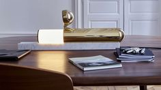 The brass-and-marble piece hides a glowing secret.