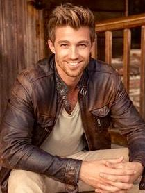 Good looking guy in brown leather jacket.