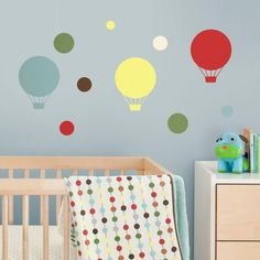 Fascinating Colorful Hot Air Balloon Wall Decal Decoration On Soft Blue Painting Wall Including Wooden Crib Babyb Beside Drawer Desk Also Circle Pattern Bedding Baby Nursery Wall Decals Creates Stylish Room with Interesting Themes Bedroom design http://seekayem.com