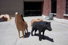 A cardboard installation called Capa Roja or the red cape project by Cazapapelesinvolves life sized wolves, their surrounding environment, ...