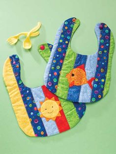 Quilting - Children & Baby Patterns - Applique Quilt Patterns - Sun & Fun Bibs ~ easy level ~ size x ~ strip-pieced ~ applique patterns for both sun and fish ~ buttons at back Baby Sewing Projects, Sewing For Kids, Sewing Crafts, Quilt Baby, Baby Bibs Patterns, Quilt Patterns, Sewing Patterns, Easy Patterns, Easy Baby Blanket