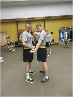 CDT Wright and CDT Dimakas working hard during Cross Fit training with LTC Remley