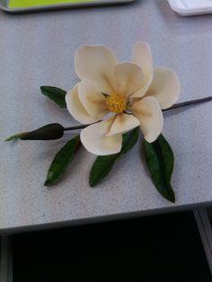Gumpaste Magnolia Gumpaste magnolia that I made in a Nicholas Lodge class Sugar Paste Flowers, Wafer Paper Flowers, Candy Flowers, Fondant Flowers, Craft Flowers, Edible Flowers, Fondant Cake Tutorial, Fondant Icing, Fondant Toppers
