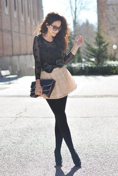Skirt with black tights.