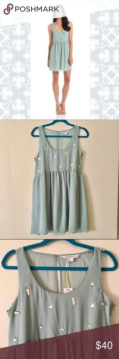 """NWT BCBGeneration Gem Embellished babydoll dress silver triangle jewels and soft gold jewels contrast a soft sea mist shift style for a comfy, flirty fit. sheer back to the waist, with a large keyhole; hook and eye closure behind the neck. 100% polyester. bust measures 18"""" across, waist 17.5"""" , length 33"""". BCBGeneration Dresses Mini"""